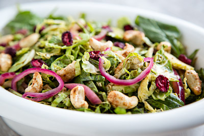 Shredded Brussels Sprouts Salad with Dried Cranberries and Cashews